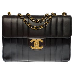 Chanel Timeless Jumbo single flap handbag in black quilted lambskin leather, GHW