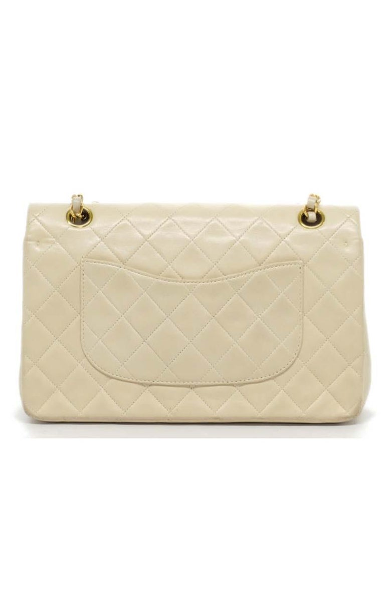 Chanel Timeless medium handbag in Ivory quilted leather and gold hardware Dimensions Height: 17cm Depth: 7cm Length: 25cm Place of Origin: France Material Notes :Quilted Lambskin Leather Condition: Very Good Wear consistent with age and use. Serial