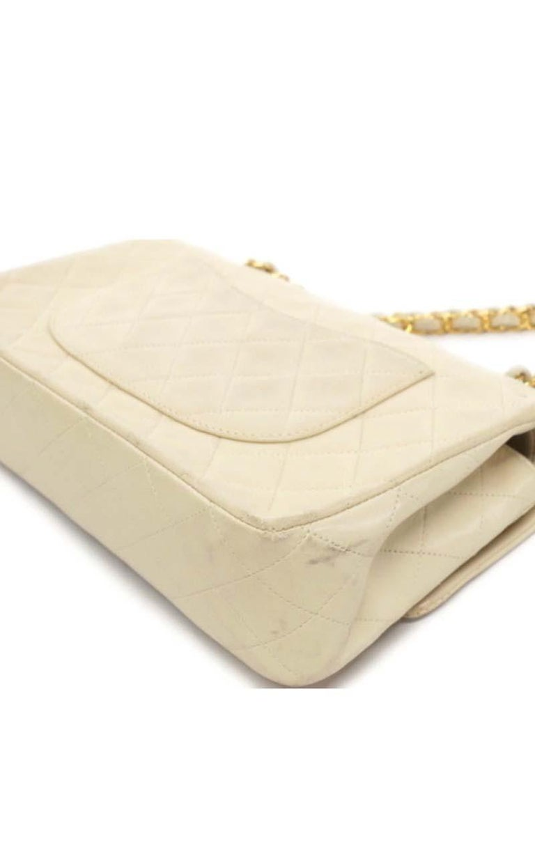 Chanel Timeless medium handbag in Ivory quilted leather and gold hardware 1