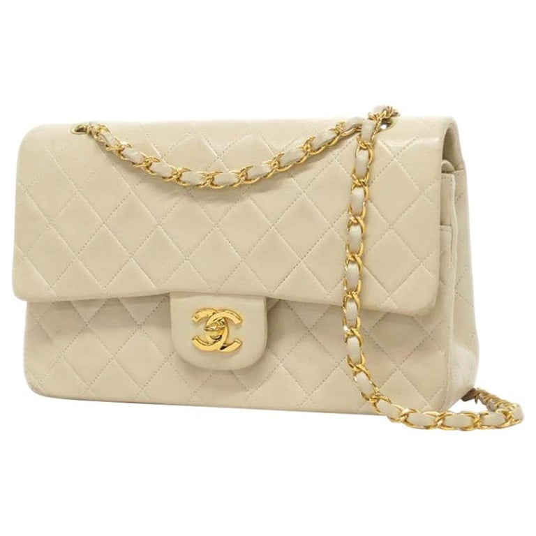 Chanel Timeless medium handbag in Ivory quilted leather and gold hardware