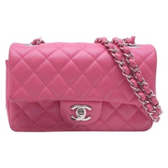 Chanel Timeless Mini handbag in Pink quilted leather and silver hardware