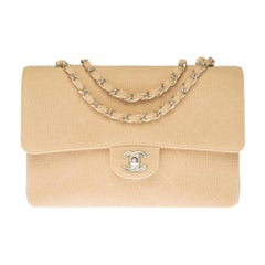 Chanel Timeless shoulder bag in beige quilted jersey with silver hardware