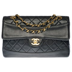 Chanel Timeless shoulder bag in black quilted leather with its wallet with GHW