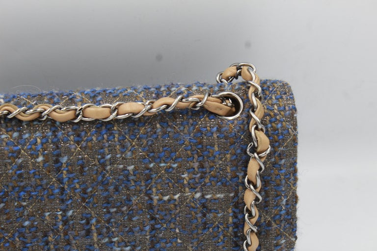 New neve used Chanel timeless double flap in tweed with silver hardware. excellent condition. Chain drop for crossbody (41cm)  Sold with dustbag card and hologram. Size 25*15