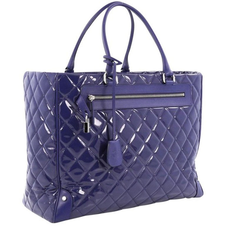 Chanel Royal Blue Patent Leather XL Quilted Carry-On Travel Bag Tote   Spring/Summer 2015  Silver hardware Royal blue patent leather Royal blue calfskin leather trims Dual-rolled leather handles Exterior zip pocket with a padlock and a hanging