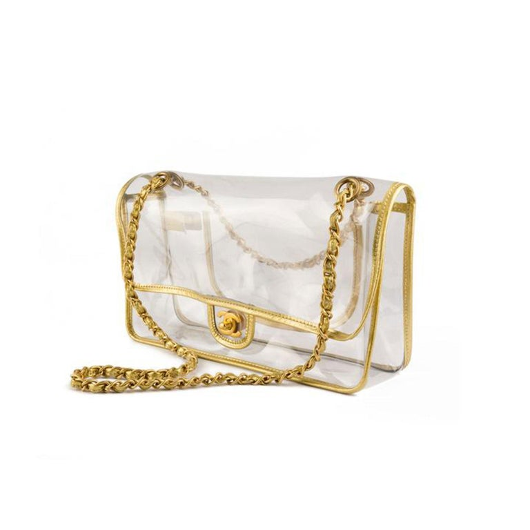 Chanel naked transparent classic flap with gold lambskin piping and signature CC turn lock.   Features gold hardware and a classic bag pocket.  In very good condition with slight scratches.  7