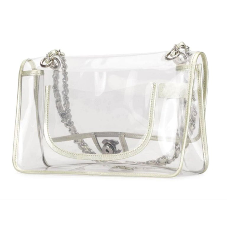 Chanel Transparent Naked Classic Silver Vintage Flap Bag  clear silver-tone hardware fold-over top with CC turn-lock fastening two leather and chain link shoulder straps back slip pocket  Made in France