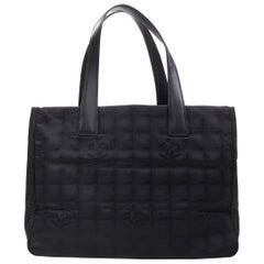 CHANEL Travel Ligne black checked CC jacquard fabric leather handle tote bag