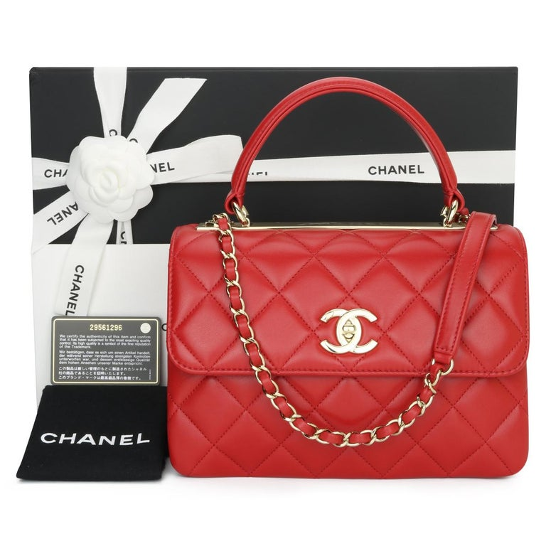 CHANEL Trendy CC Top Handle Flap Bag Small Red Quilted Lambskin with Light Gold Hardware 2020.  This stunning bag is in pristine condition, the bag still holds its original shape, and the hardware is still very shiny. The leather smells fresh as if
