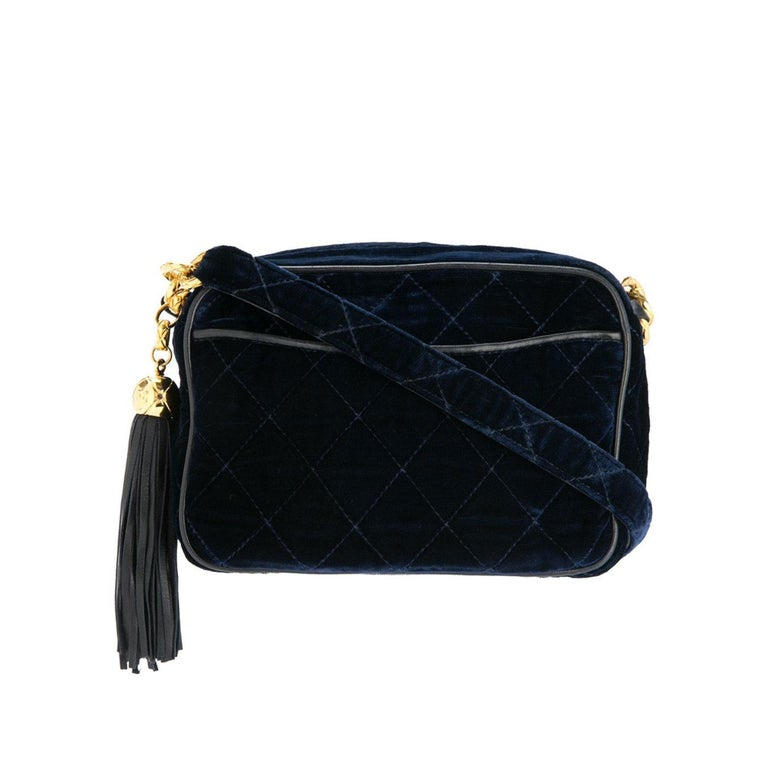 Chanel Ultra Rare Mini Vintage Blue Roi Velvet Fringe Tassel Clutch Camera Tote  1991 {VINTAGE 27 Years}  Navy blue velvet Lined blue lambskin leather Gold-tone hardware Diamond quilted finish Chain and leather strap Top zip closure Main internal