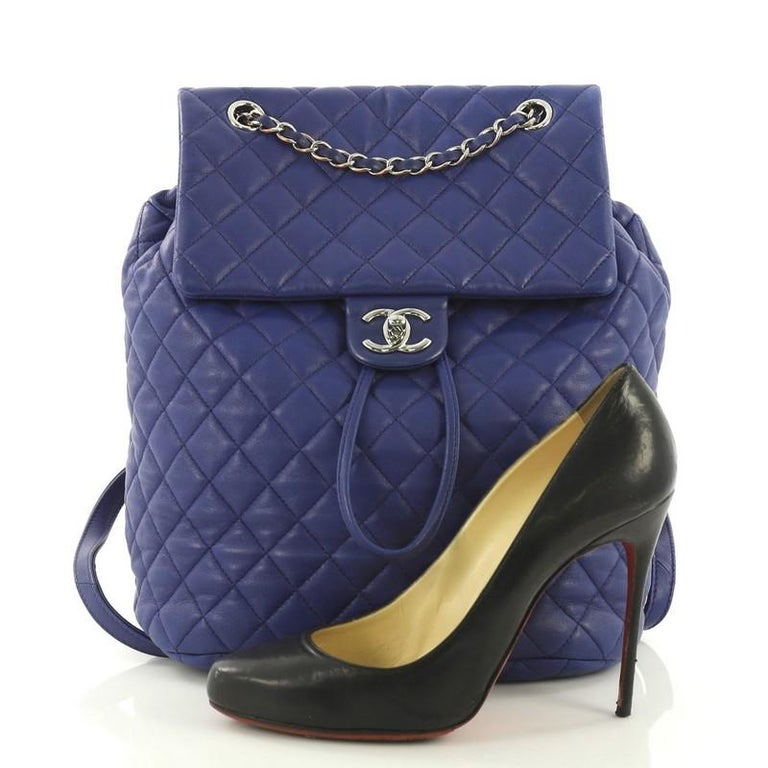79b80541b370 This Chanel Urban Spirit Backpack Quilted Lambskin Large, crafted in blue  quilted lambskin, features