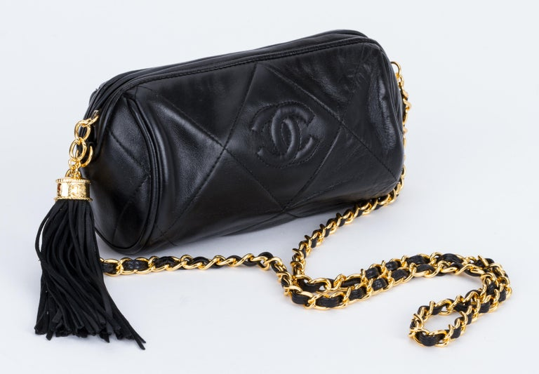 f5d2fc16fd21 Chanel 90s round black quilted evening bag with dangling tassel. Excellent  condition. Shoulder drop. Chanel Vintage 1990's Black Leather ...