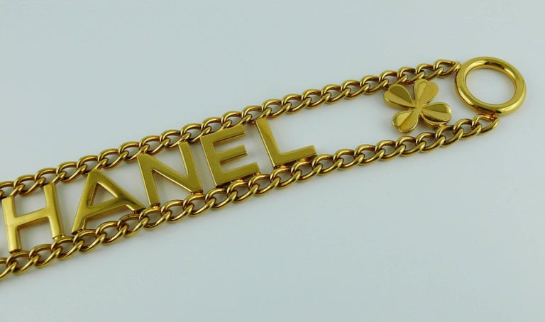 Black Chanel Vintage Gold Toned Chain Belt with Chanel Letters and Clovers, 1998  For Sale