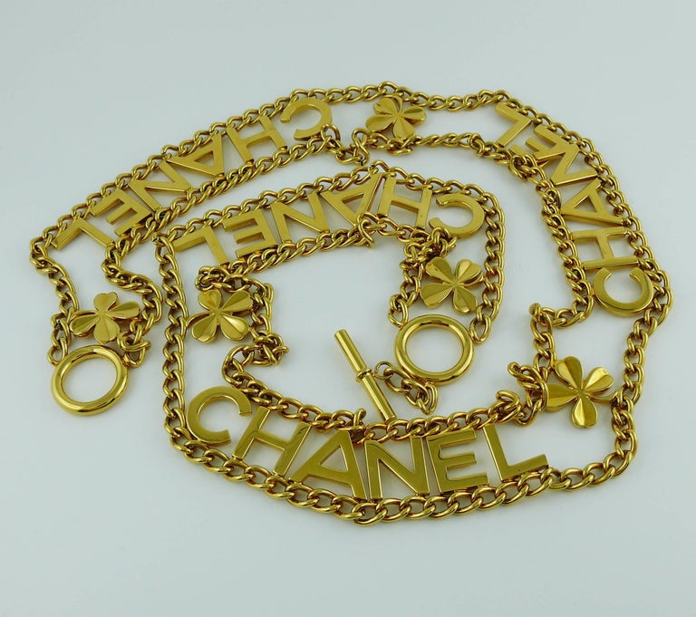 Women's Chanel Vintage Gold Toned Chain Belt with Chanel Letters and Clovers, 1998  For Sale