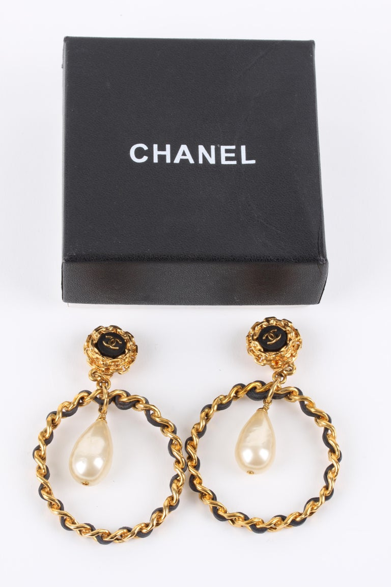 These authentic vintage Chanel beauties are from the 90's, true statement pieces!  The gold-tone clip on top has a black center with CC logo. On the back 'CHANEL made in France 93P' is embossed. A large drop shaped faux pearl is attached to the