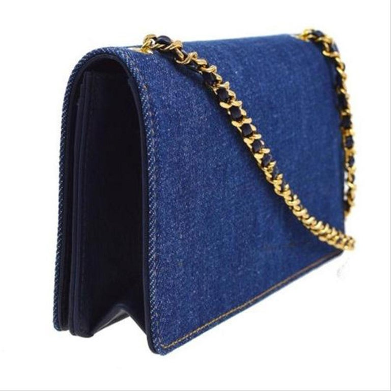 Chanel Rare Vintage 90's Denim WOC Wallet on a Chain   1996 {VINTAGE 25 Years}  Gold hardware Classic leather interwoven single chain CC Stitched Logo at front Navy leather interior lining Three interior compartments Single coin pouch, four card