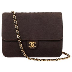 CHANEL vintage bag in brown jersey with golden chain