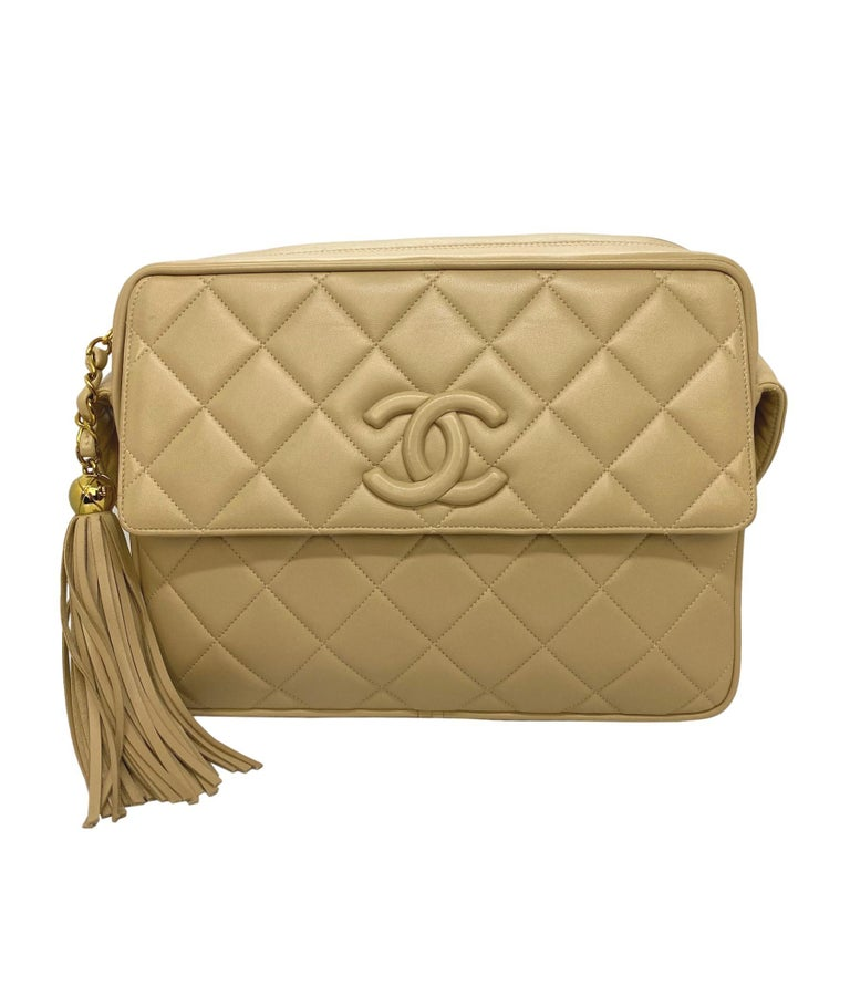 Chanel Vintage Beige Quilted Lambskin Leather Camera Bag with Gold Hardware. This highly coveted and rare collectible crossbody camera bag was produced between 1994 - 1996, baring a serial code of