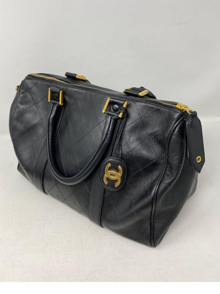 Chanel Black Vintage Boston Bag. Classic bowler or doctor's bag style by Chanel. Vintage gold plated hardware. Good condition. One side of handles has some wear. The handle is slightly bent from use. Not very noticeable. Please see all photos.