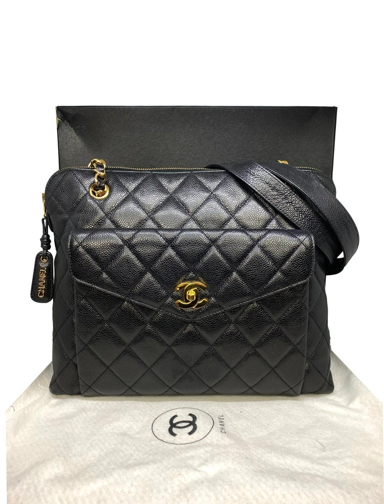 Chanel Vintage Black Quilted Caviar Leather Shoulder Bag with Gold Hardware, 1996 - 1997. Crafted from the classic and Chanel's most durable black caviar leather, this Chanel Logo shoulder bag features a mademoiselle chain toggle and front pocket