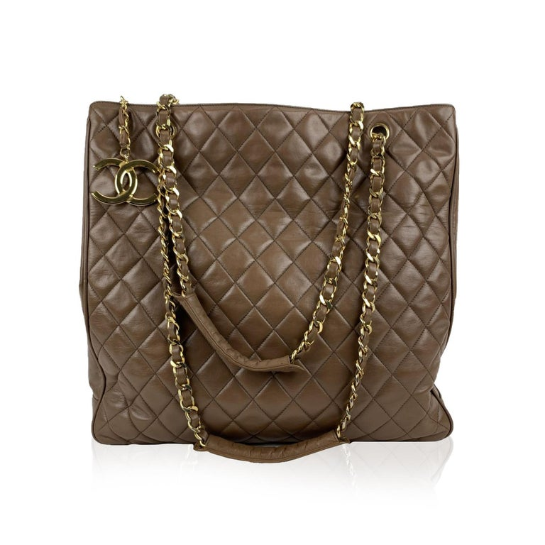 This bag will come with a Certificate of Authenticity provided by Entrupy, at no further cost.  Beautiful vintage CHANEL tote from the late '80. Made of brown quilted leather. Big CC - CHANEL logo on the front. Brown leather lining. The main