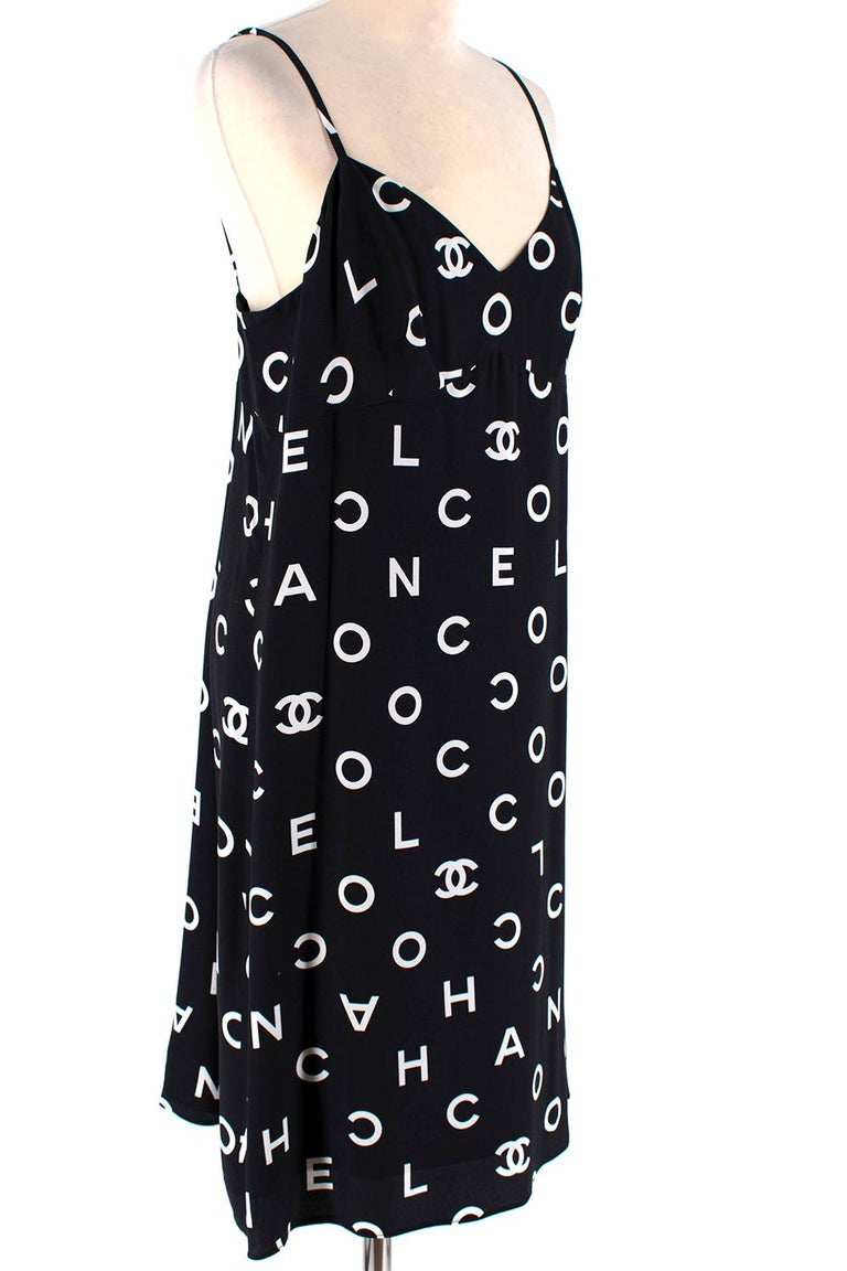 Chanel Vintage Black & White Coco Logo Sleeveless Mini Dress  - COCO logo body, white on black - Vintage Spring 1997 collection - Beautiful Bralette Strap - Logo Chanel Buttons  - Zip and button closure to the back  -Unlined and