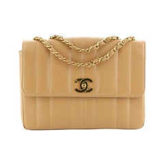 Chanel  Vintage CC Chain Flap Bag Vertical Quilt Caviar Medium