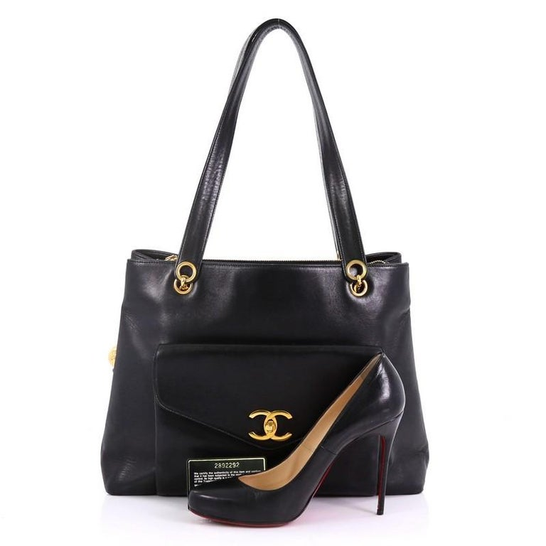 f64a4439f513 This Chanel Vintage CC Front Pocket Shoulder Bag Lambskin Medium, crafted  in black lambskin,
