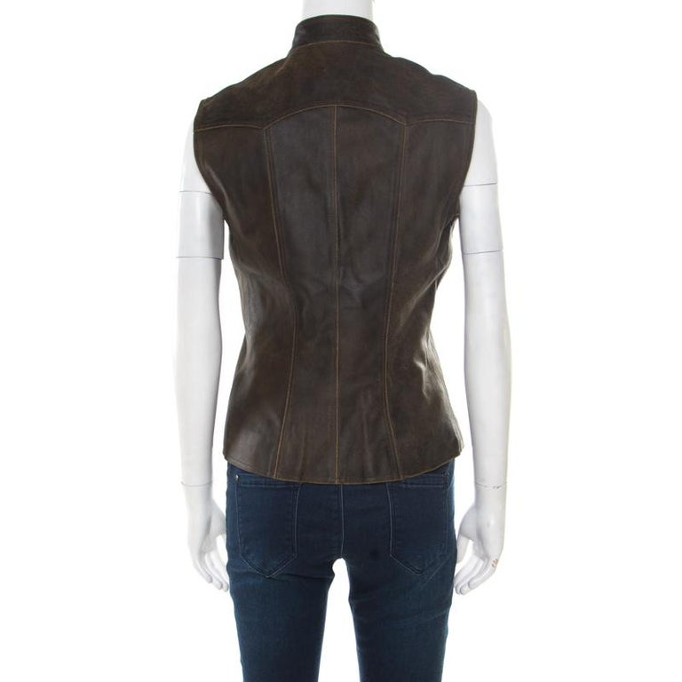Let your closet experience a stylish addition with this vest from Chanel. It is well tailored from dark brown calfskin leather and features a buttoned fastening at the front embossed with the signature CC logo. It has a stylish silhouette,