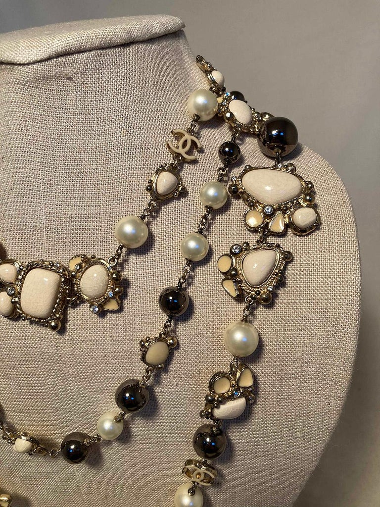 Chanel Vintage Enamel and Pearl Necklace in very good condition. pearl and gunmetal beads on silver chain with enamel stone accents and crystal details. Can be worn doubled or tripled around neck. No missing stones or scratches on beads. Very light