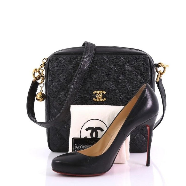 ae21baba36d5 This Chanel Vintage Front Pocket Camera Shoulder Bag Quilted Caviar Medium,  crafted in black quilted