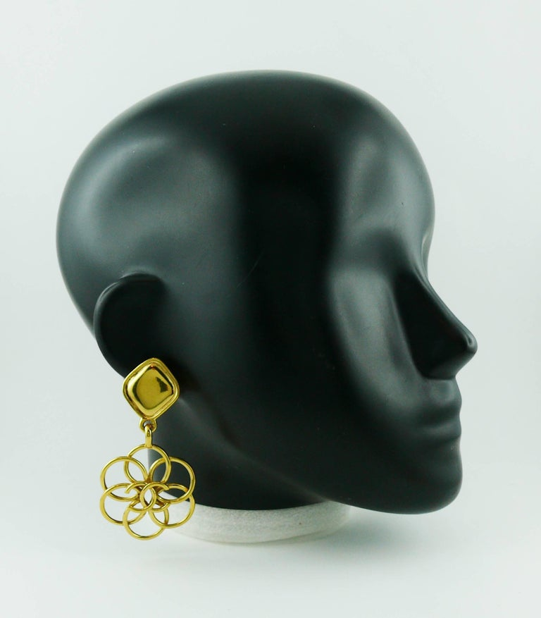 CHANEL vintage gold toned dangling earrings (clip-on) featuring a diamond shape top and a large abstract wired flower with CC logo at center.  Marked CHANEL Made in France.  Indicative measurements : height approx. 7.6 cm (2.99 inches) / max. width