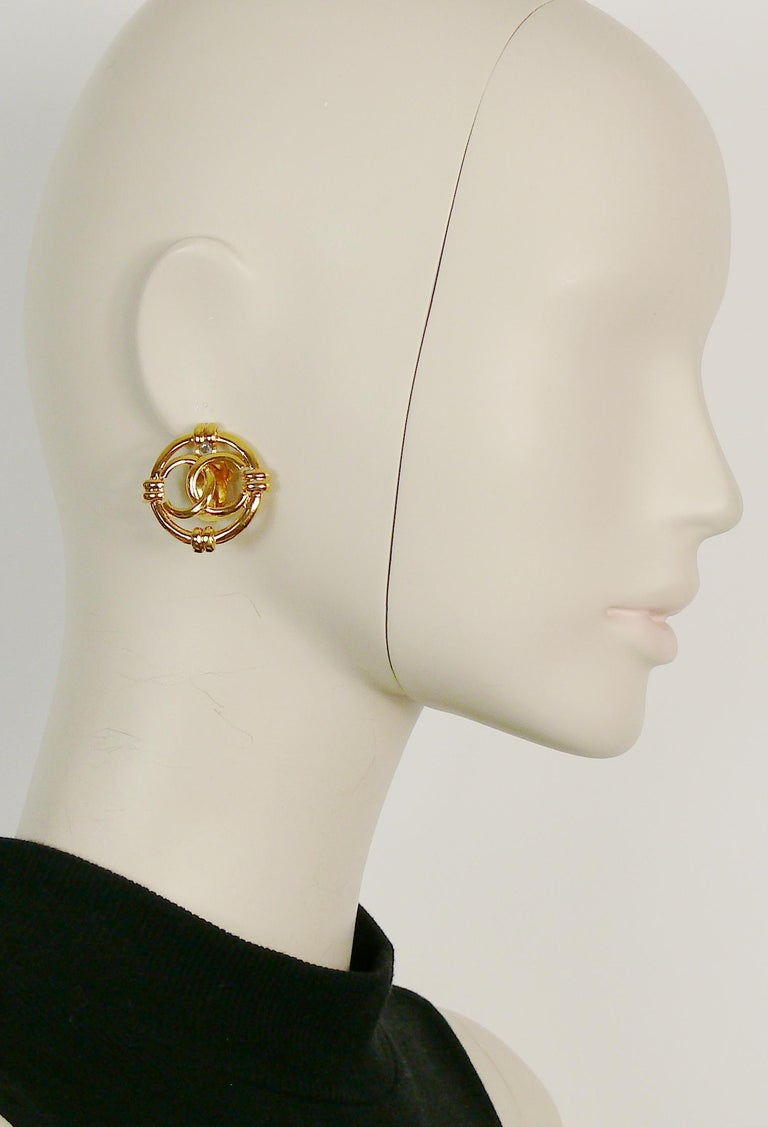 CHANEL vintage gold toned openwork CC logo disc clip-on earrings.  Collection 29 (year 1994).  Marked CHANEL 29 Made in France.  Indicative measurements : diameter approx. 3 cm (1.18 inches).  Comes with a CHANEL box.  NOTES - This is a preloved