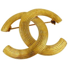 Chanel Vintage Gold Toned Ribbed CC Brooch