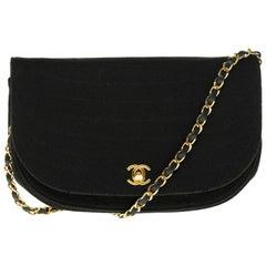 Chanel vintage half moon handbag in black quilted cotton, Gold hardware