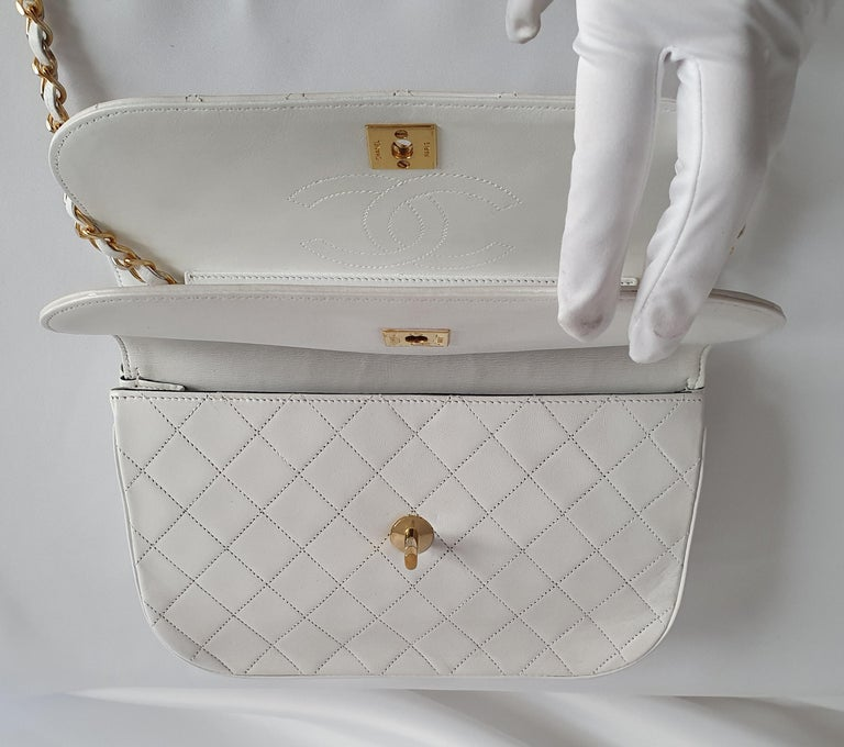 - Designer: CHANEL - Model: Vintage - Condition: Very good condition. Sign of wear on Leather, Bag restored by a professional - Accessories: Authenticity Card - Measurements: Width: 24cm , Height: 16cm , Depth: 5,5cm , Strap: 84cm  - Exterior