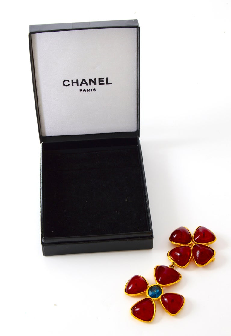 A wonderful 1980s signed brooch dating from the Karl Lagerfeld 36-year tenure at Chanel when more was definitely more.  The modified Verdura Maltese Cross recalls the cross motifs that entered the Chanel lexicon in the late 1920s when she