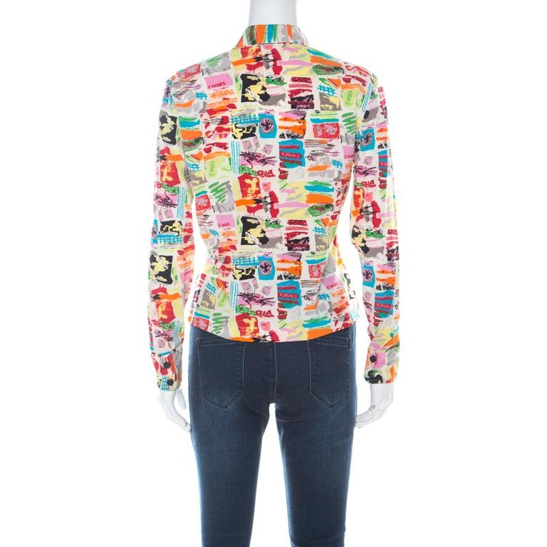 When it comes to wearing a Chanel creation, you are bound to make an impression! This shirt is made of a silk blend and features a multicolour abstract printed pattern all over it. It flaunts a cropped design, front button fastenings and long cuffed