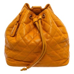 Chanel Vintage Mustard Yellow Caviar Leather Drawstring Backpack