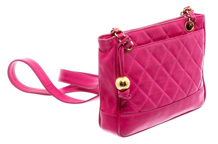 Pink quilted leather vintage Chanel tote with gold-tone hardware, dual chain-link and leather shoulder straps, dual slip pockets at exterior, beige lambskin lining, single zip pocket at interior wall and zip closure at
