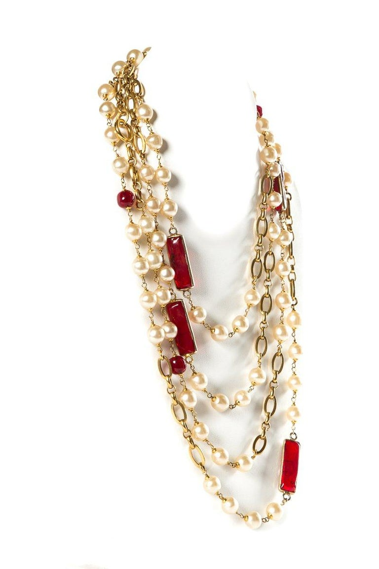 Chanel red Gripoix and faux pearl vintage 1980's necklace with gold-tone hardware and chain links.   This item has been previously worn and contains some signs of wear including micro-scratches on hardware. Good previously used condition consistent