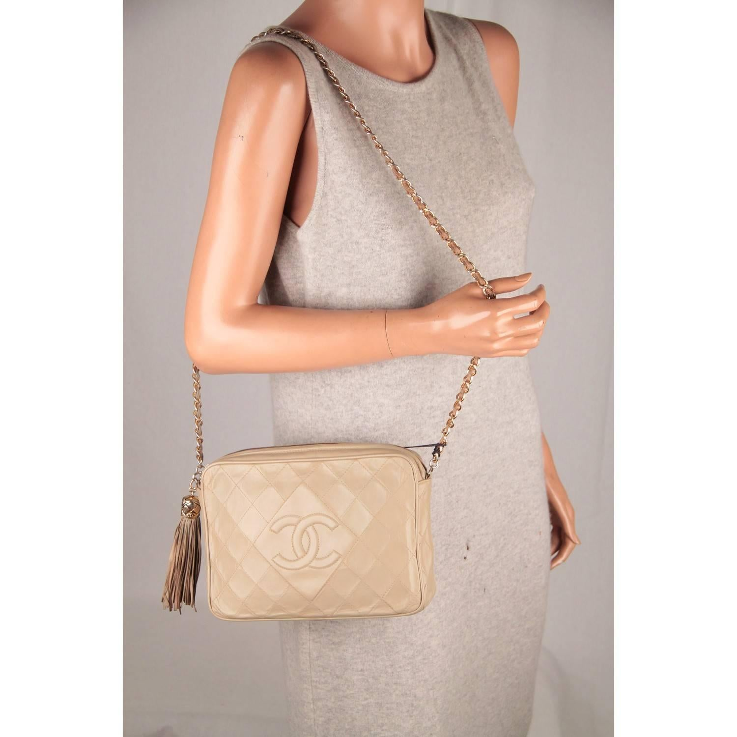 709352f772da CHANEL Vintage Taupe Quilted Leather CC LOGO Camera Bag with Tassel For Sale  at 1stdibs