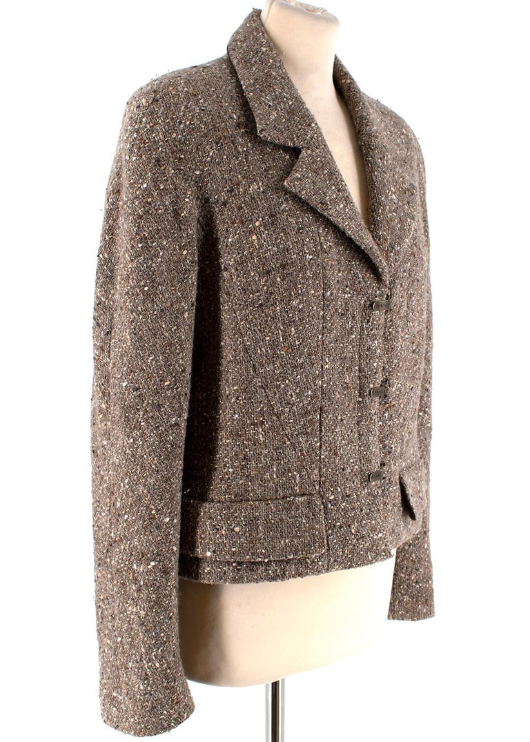 Chanel Taupe Wool Blend Tweed Jacket  -Made of a soft wool blend  -Signature tweed texture  -Classic cut -Branded Clasp fastening to the front  -CC logo branding to the lining -Faux pocket details to the front -Luxurious silk lining -Chain to the