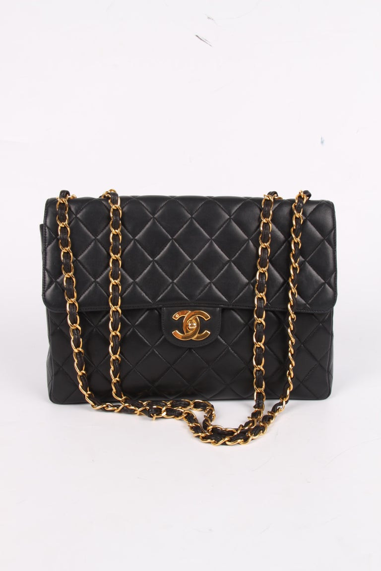 A vintage classic by Chanel: the Timeless Jumbo Flap Bag in black lambskin leather.    This 2.55 Jumbo Timeless Flap Bag is from 1994-1996 and its the larger size of this classic model. It measures as much as 30 centimeters in length.  A chunky