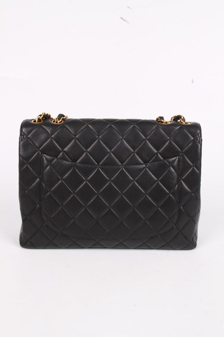 Women's or Men's Chanel Vintage Timeless Jumbo Single Flap Bag - black/gold For Sale