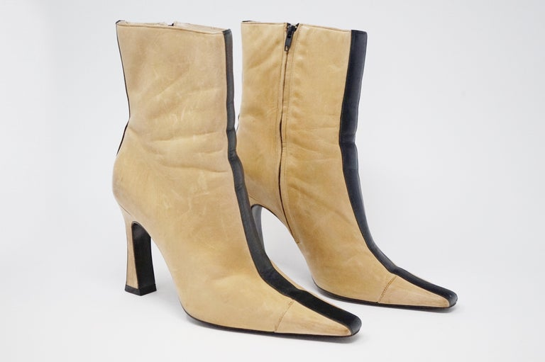 Extremely rare vintage Chanel two-tone buttery soft lambskin heeled boots in iconic black and beige, circa 1960.  These exquisite examples are stamped