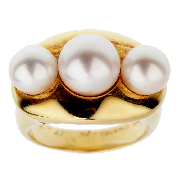 A chic Chanel vintage cocktail ring circa 1990s showcasing 3 pearls set in 18k yellow gold. The ring measures a size 6 1/2 and can be resized.