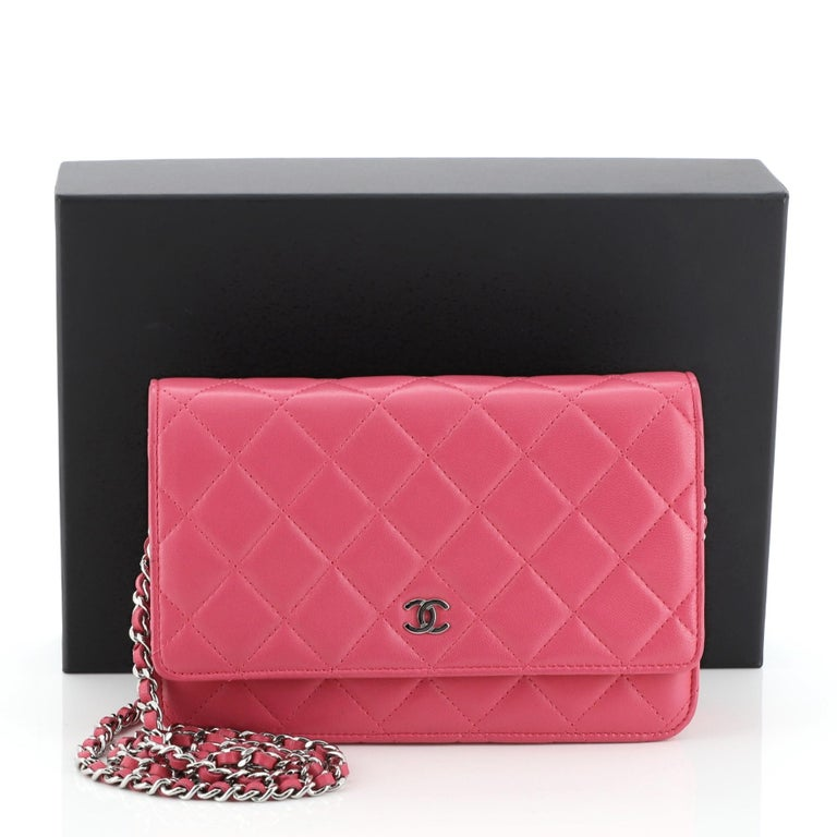 This Chanel Wallet on Chain Quilted Lambskin, crafted in pink quilted lambskin leather, features woven-in leather chain strap, front flap with CC logo, exterior back slip pocket, and silver-tone hardware. Its magnetic snap button closure opens to a