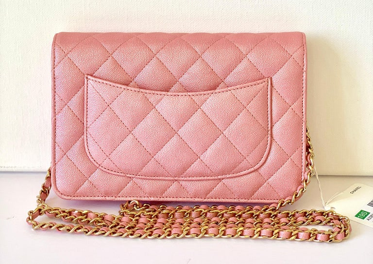 Wallet on Chain Bag This piece is SOLDOUT! Iridescent Pearlized Pink Caviar with Gold Doesnt get better than this! CC is done in Gold  Wallet on Chain  This is a treasure! Use for evening or during the day! So versatile    Comes with box, tag and