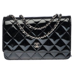 Chanel Wallet on Chain (WOC) shoulder bag in black quilted patent leather, SHW